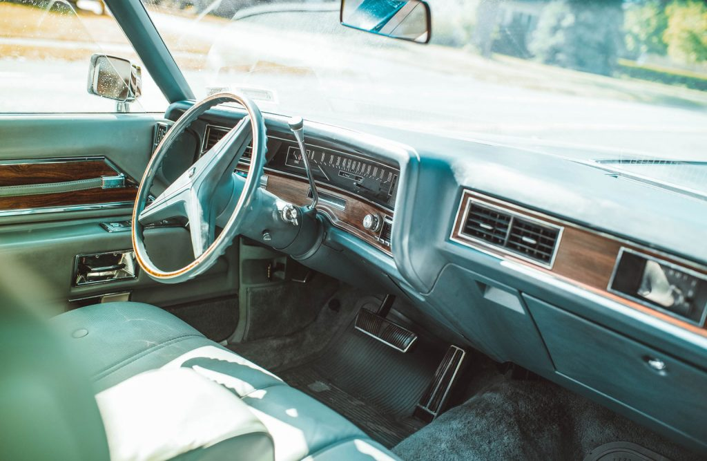 Interior of a classic Cadillac car.