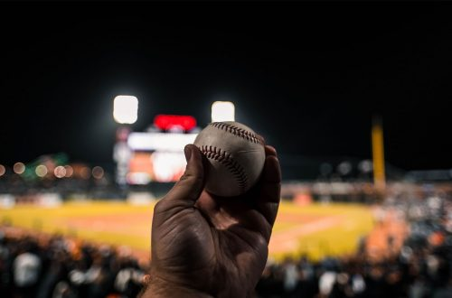 Man holding baseball in his hand.