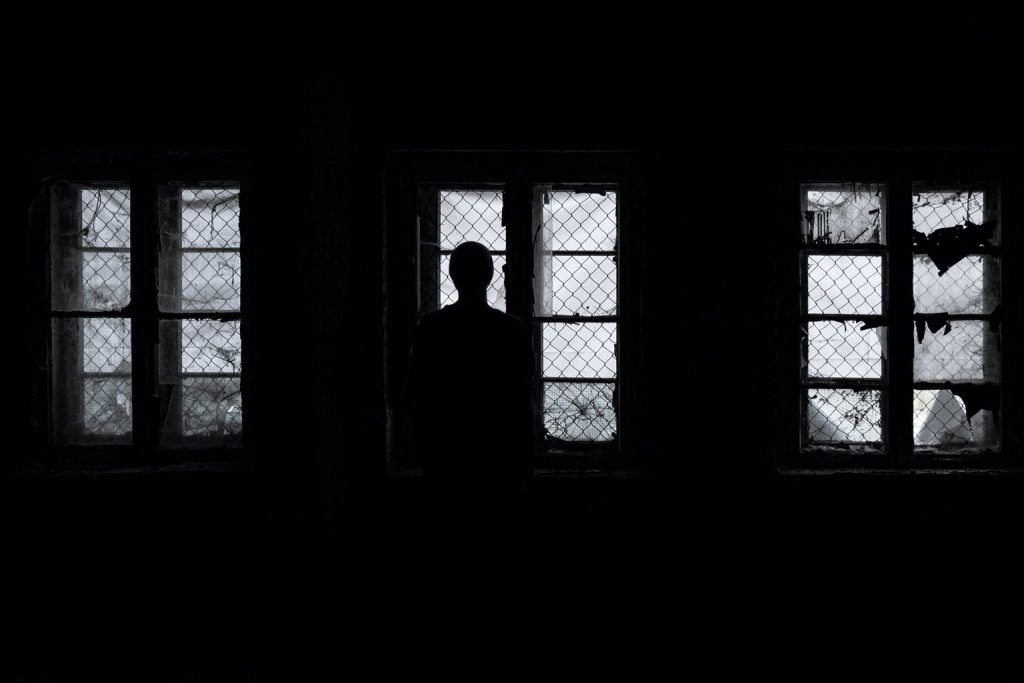 Silhouette of a man in an abandoned house.